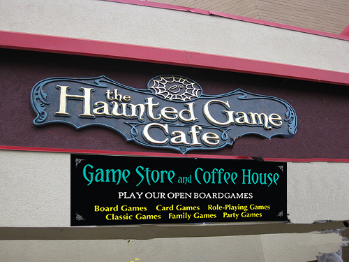 New business branding store sign Haunted Game Cafe graphic design